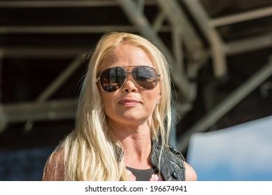 KALLINGE, SWEDEN - JUNE 01, 2014: Swedish Air Force air show 2014 at F 17 Wing. The group Hitmaskinen performing on stage. Singer Jenny Redenkvist.