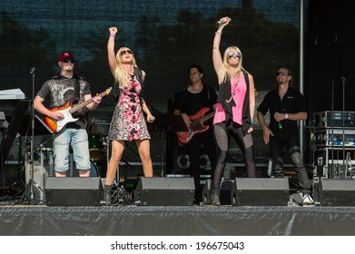 KALLINGE, SWEDEN - JUNE 01, 2014: Swedish Air Force air show 2014 at F 17 Wing. The group Hitmaskinen performing on stage.