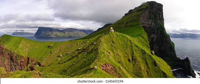 Kallur lighthouse on Kalsoy island on Faroe islands with cliffs, sea, grass and everything to make you feel like WOW