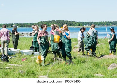KALMAR, SWEDEN - MAY 26: Female students on ecology, biology field trip to study marine life.