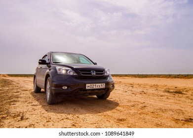 Kalmykia, Russia - May 6, 2018: Black modern car SUV Honda CRV in semi-desert region. Offroad travelling