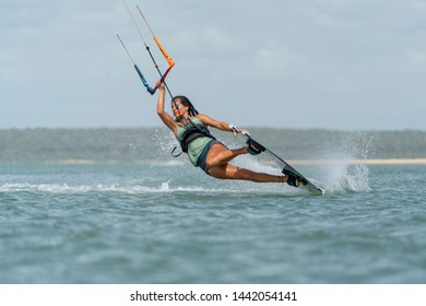 Kalpitiya Sri Lanka - 10.06.2019: Young beautiful girl doing a darkslide trick during her kitesurfing session in Sri Lanka