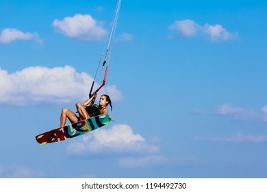Kalpitiya, Sri Lanka - Dec 23, 2017 :  Kitesurfer girl is having while she is surfing in Kalpitiya.