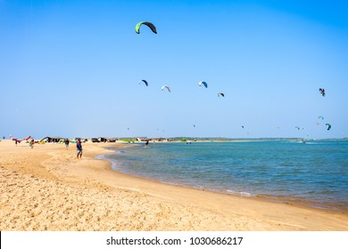 KALPITIYA, SRI LANKA - FEBRUARY 09, 2017: Kitesurfers at the Kalpitiya beach in Sri Lanka. Kalpitiya is the best kitesurfing destination in Asia.
