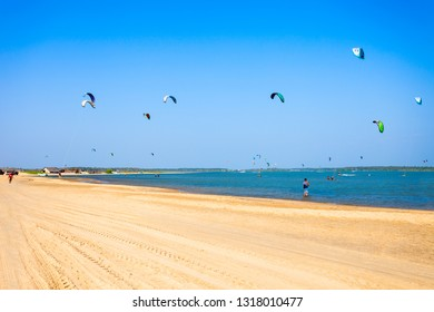 KALPITIYA, SRI LANKA - FEBRUARY 09, 2017: Kitesurfers at the Kalpitiya beach in Sri Lanka. Kalpitiya is the best kitesurfing destination in Asia.