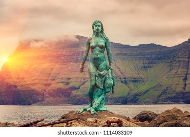 Kalsoy Island, Faroe Islands -JUNE 2018: Statue of Kopakonan (the Seal Woman), Mikladalur village, Faroe Islands