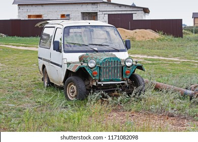 Kaluga region, Russia - August 15, 2018: Hybrid homemade car from Isuzu midi and GAZ 67 stands in the village in Kaluga region