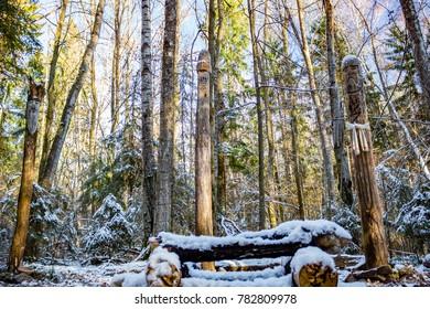 Kaluga region, Russia - November 2017: Slavic pagan idols on the forest temple. Veles, Makosh and Perun