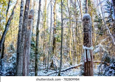 Kaluga region, Russia - November 2017: Slavic pagan idols on the forest temple.  Makosh and Perun