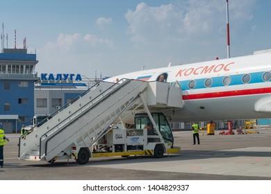 Kaluga, Russia - April 27 2019: airplane Tu-134 with ladder on the runway in international airport in Kaluga