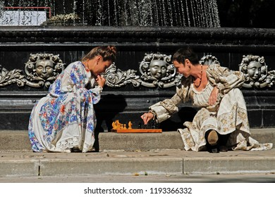 Kaluga, Russia - August 22, 2015: Women playing chess near the city fountain in Kaluga