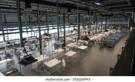 Kaluga, Russia - February 25, 2021: The interior of the garment factory Bosco Manufactory (Bosco di Ciliegi). Seamstresses work in the main sewing shop.