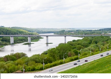 Kaluga, Russia - May 11, 2019: Entrance to the city and beautiful view of the bridge across The Oka river from the observation point in the Park of culture and recreation