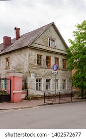 Kaluga, Russia - May 11, 2019: old green country style two floor house