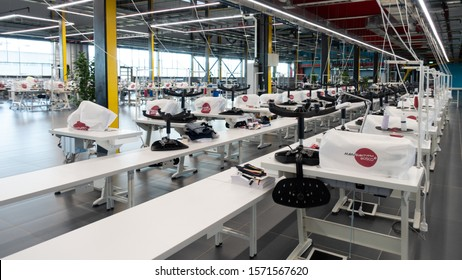 Kaluga, Russia - November 22, 2019: The interior of the garment factory Bosco Manufactory (Bosco di Ciliegi). The main sewing shop with empty workplaces.