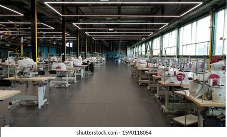 Kaluga, Russia - November 22, 2019: The interior of the garment factory Bosco Manufactory (Bosco di Ciliegi). The main sewing shop.