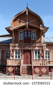 KALUGA, RUSSIAN FEDERATION - APRIL 17, 2016: Wooden house with carved windows and unusual roof in Kaluga city (Museum of folk crafts). Russian style in architecture