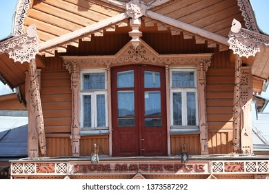 KALUGA, RUSSIAN FEDERATION - APRIL 17, 2016: Detail of wooden house with carved windows and unusual roof in Kaluga city (Museum of folk crafts). Russian style in architecture