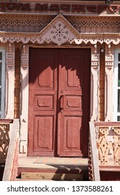KALUGA, RUSSIAN FEDERATION - APRIL 17, 2016: Carved door of wooden house in Kaluga city (Museum of folk crafts). Russian style in architecture