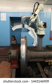 KALUGA, RUSSIAN FEDERATION - JULY 5, 2019: Automated nondestructive testing of railway elements (train wheel) at plant. Robotic technologies and automation in Russian industry