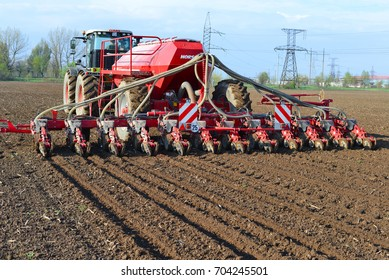 Kalush, Ukraine - April 14: Planting corn trailed planter in the field near the town of Kalush, Western Ukraine April 14, 2016