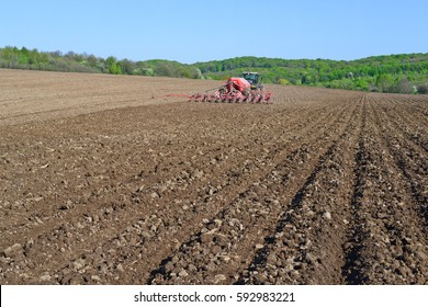 Kalush, Ukraine - April 18: Planting corn trailed planter in the field near the town of Kalush, Western Ukraine April 18, 2016