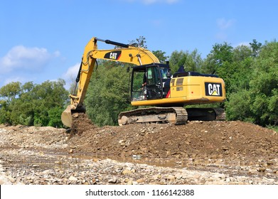 Kalush, Ukraine - August 18, 2018: Gravel excavated in the mainstream of the river.