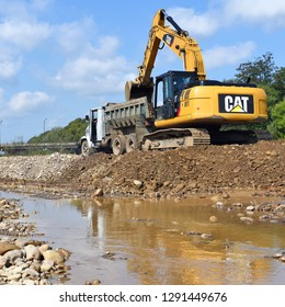 Kalush, Ukraine - August 18, 2018: Loading gravel in the car body on the construction of a protective dam near the town of Kalush.