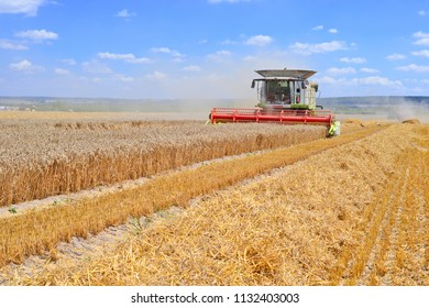 Kalush, Ukraine August 2, 2016: Modern Claas combine harvester at the harvest of cereal near the town Kalush, Western Ukraine.