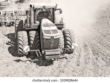 Kalush, Ukraine August 2, 2017: Modern tractor with a trailed seeder on the sowing of cereals near the town Kalush, Western Ukraine.