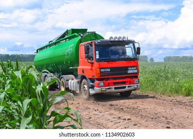 Kalush, Ukraine  July 12, 2017: A truck with a liquid tank carries water along a dirt road through a corn field near the town of Kalush,Western Ukraine.