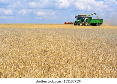 Kalush, Ukraine  July 20, 2018: On the harvest of cereals near the town Kalush, Western Ukraine.