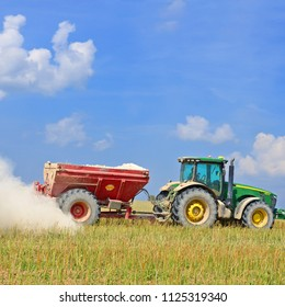 Kalush, Ukraine - July 25, 2016: Adding lime to the soil after harvest in the field near the town Kalush, Western Ukraine J