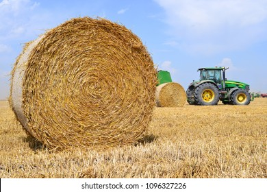 Kalush, Ukraine - July 28: Universal tractor harvesting straw in the field near the town Kalush, Western Ukraine July 28, 2016