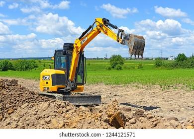 Kalush, Ukraine- June 15, 2017: A modern excavator JCB is performing excavation work on the pipeline repair near the city of Kalush, Western Ukraine.