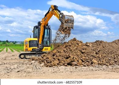 Kalush, Ukraine- June 15, 2017: The modern excavator JCB performs excavation work on the construction site near the city of Kalush, Western Ukraine.