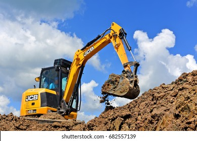 Kalush, Ukraine- June 15, 2017: The modern excavator JCB performs excavation work on the construction site near the city of Kalush, Western Ukraine.