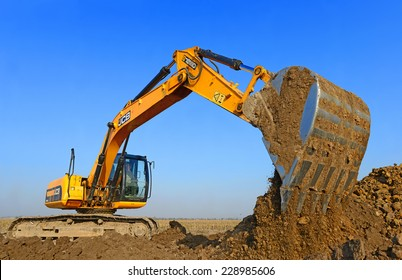 Kalush, Ukraine  October 14: Modern JCB excavator on the highway pipeline performs excavation work in the field near the town Kalush, Western Ukraine October 14, 2014