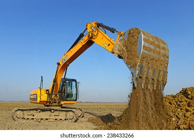 Kalush, Ukraine October 14: Modern JCB excavator on the highway pipeline performs excavation work in the field near the town Kalush, Western Ukraine October 14, 2014