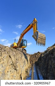 Kalush, Ukraine â?? October 7: Modern JCB excavator on the highway pipeline performs excavation work in the field near the town Kalush, Western Ukraine October 7, 2014