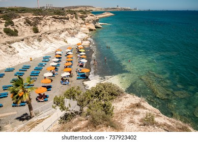 Kalymnos beach, Cyprus, July 2017:A small Kalymnos beach with a few deck chairs and umbrellas, between Larnaca and Limassol