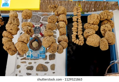 Kalymnos, Greece - July 06, 2018: Beautiful organic healthy natural sponges small big pieces from the mediterranean sea on a greek island, Kalymnos, Greece. Sponge market in Kalymnos.