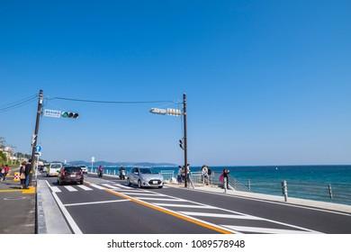 "KAMAKURA CITY, KANAGAWA / JAPAN - APRIL 28 2018 : Scenery of the coastal road of ""Shichirigahama"". In front of the station ""Kamakura koko mae"" Station is a spot where many tourists visit."
