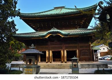 "KAMAKURA CITY, KANAGAWA PREFECTURE, JAPAN - DECEMBER 8, 2020: A Front View of the ""Butsu-den"" Buddhist Sanctum of ""Kofukusan Kenchou Koukoku Zenji"" Temple; ""Jizo-bosatsu (Ksitigarbha) Is in the Hall."