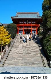 "KAMAKURA CITY, KANAGAWA PREFECTURE, JAPAN - DECEMBER 8, 2020: People Wearing COVID-19 Masks Going Up and Down the Stone Steps in Front of the Main Sanctuary of ""Tsurugaoka Hachiman-gu"" Shinto Shrine"