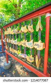 Kamakura, Japan - April 23, 2017: Ema praying tablets at Tsurugaoka Hachiman, the most important Shinto shrine built in 1063 in ancient Japan. Ema are small wooden plaques used for wishes.