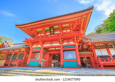 Kamakura, Japan - April 23, 2017: Romon the Great Gate at Tsurugaoka Hachiman Shinto shrine.Above the gate is a plaque bearing the name of the shrine, Hachimangu, written in 1629 by Prince Ryoujo.