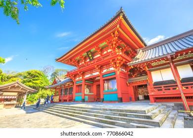Kamakura, Japan - April 23, 2017: main hall or Hongu or Jogu at the top of a wide stairway. Tsurugaoka Hachiman, is the most important Shinto shrine in Kamakura. Springtime in the blue sky.