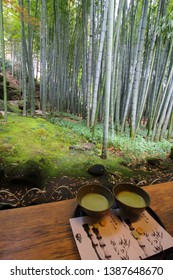 Kamakura, Japan - April 7, 2019 : Two cups or bowls with fresh matcha tea in the giant bamboo garden in Kamakura, Japan
