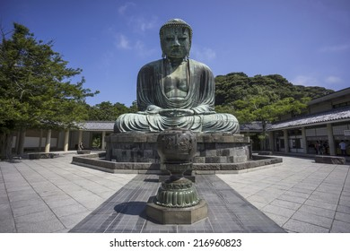 """Kamakura, Japan - August 7, 2014: The Great Buddha (""""Kamakura Daibutsu"""") , which stands on the grounds of Kotokuin Temple, is the second bigest in the country."""
